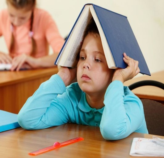 kid with book onhead